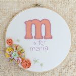 "A picture of a blanket stitched frame that says ""M is for Maria"""