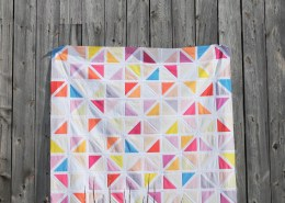 An image of a quilt made with a pattern of two triangle blocks